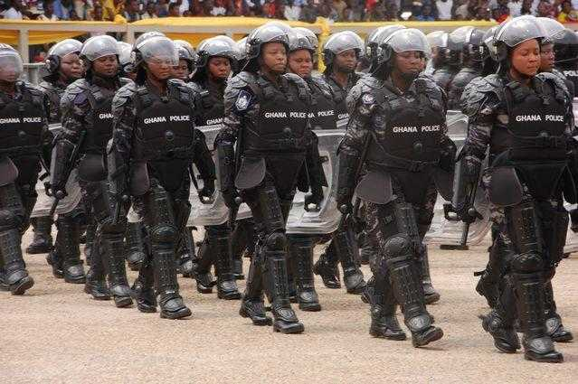 Police women dressed in full body armour on parade