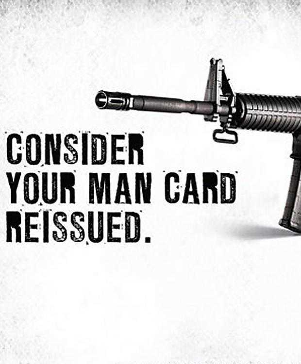 "An advert for the Remington Bushmaster rifle. A picture of a gun with the words ""Consider your man card reissued."""