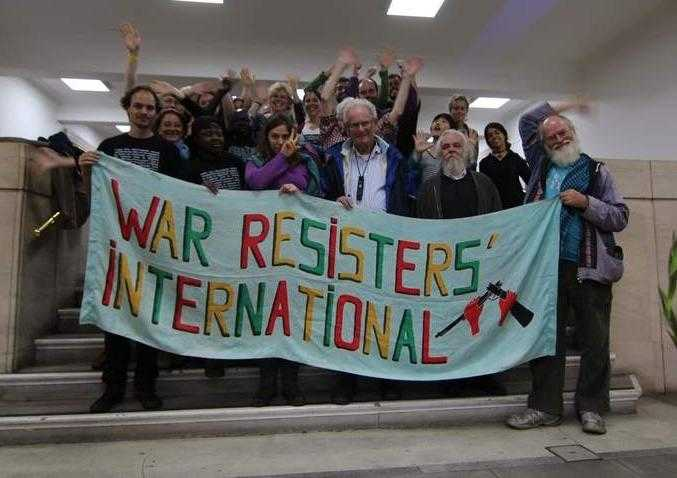 WRI members behind our banner!