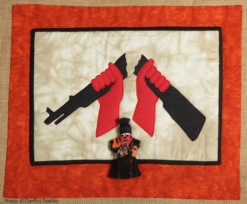 Broken Rifle 2, Northern Ireland arpillera, Irene MacWilliam, 2013, Photo Martin Melaugh, Conflict Textiles collection