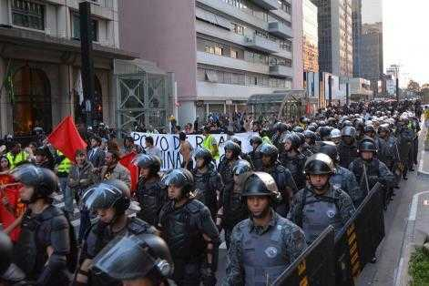 A protest against the World Cup in Brazil is heavily policed