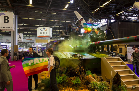 Protesters occupy a tank at the Eurosatory arms fair