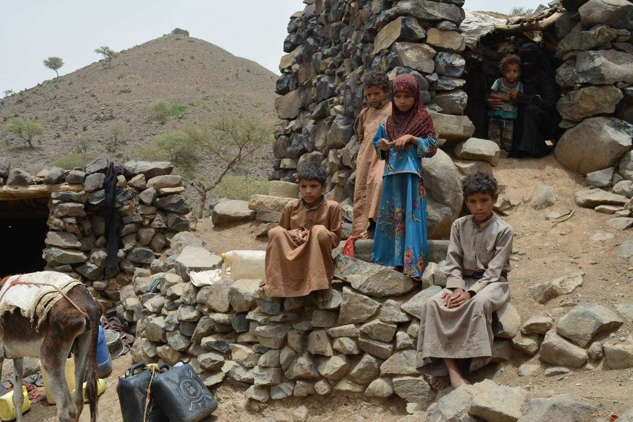 Children in Yemen standing outside the house