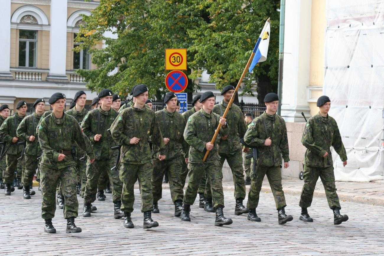 Soldiers marching in a military town