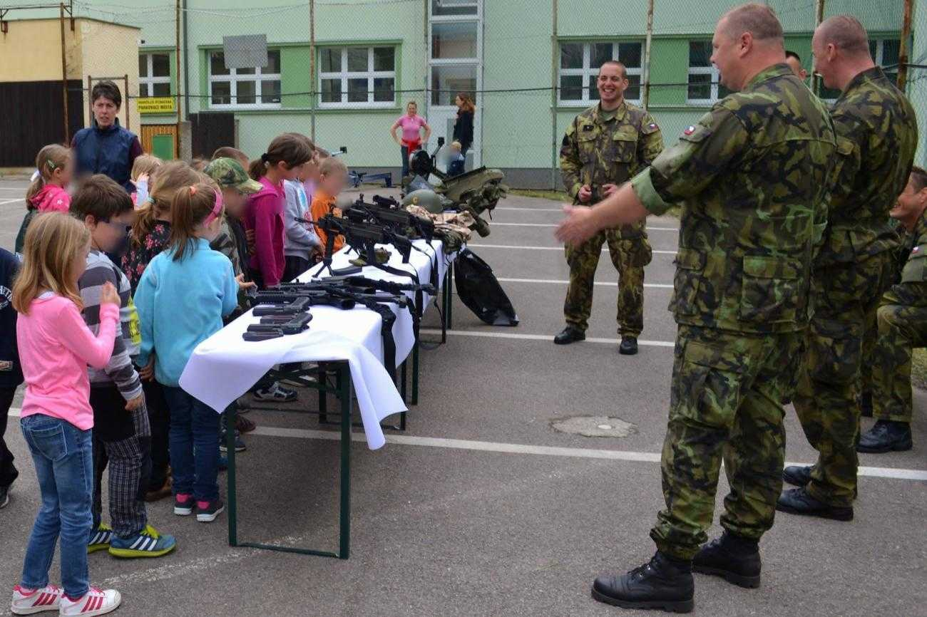 Military personnel visiting a school in Czech Republic