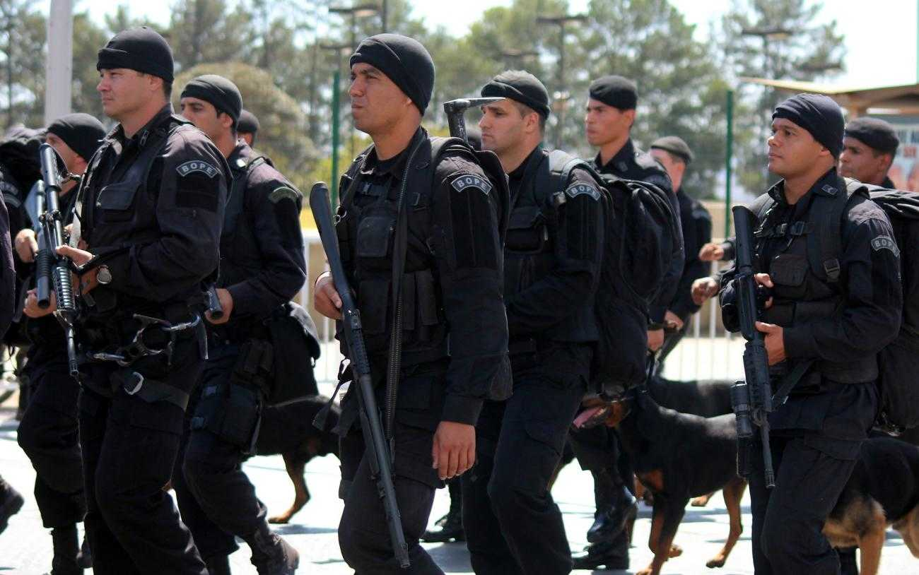 Several black-clad and heavily armed police officers
