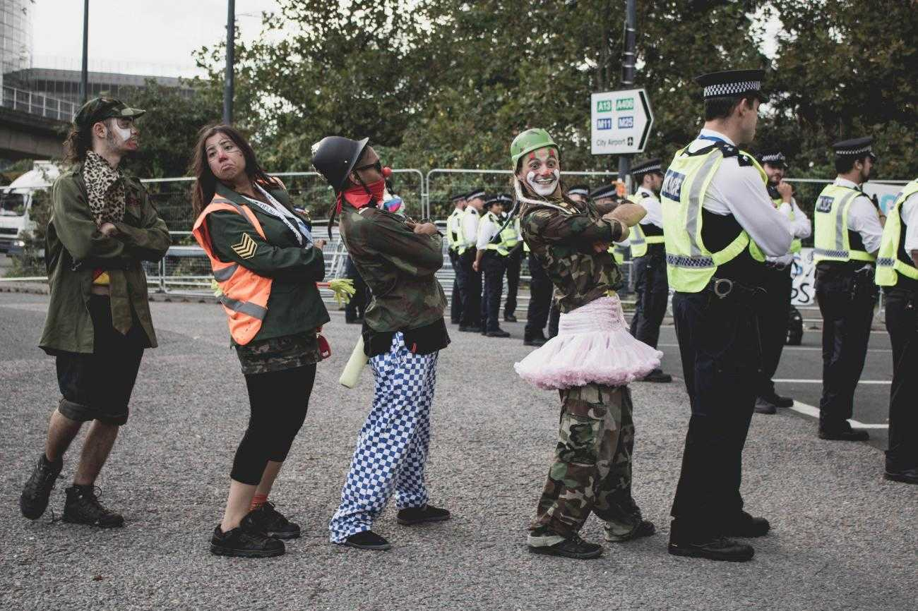 A group of clowns mock police at DSEI protests.