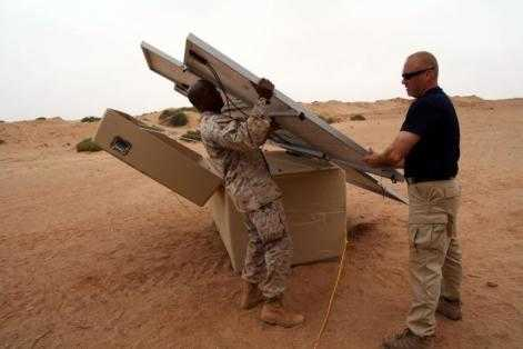 US soldiers install solar panels. Source: wikipedia