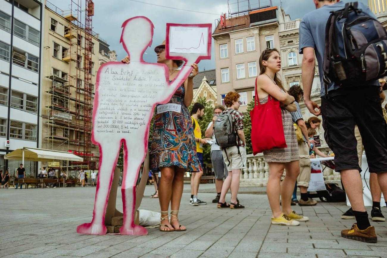Activists in Brno display signs shaped like people with information about the Czech arms trade