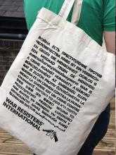 "A plain ""war is a crime against humanity"" tote bag."