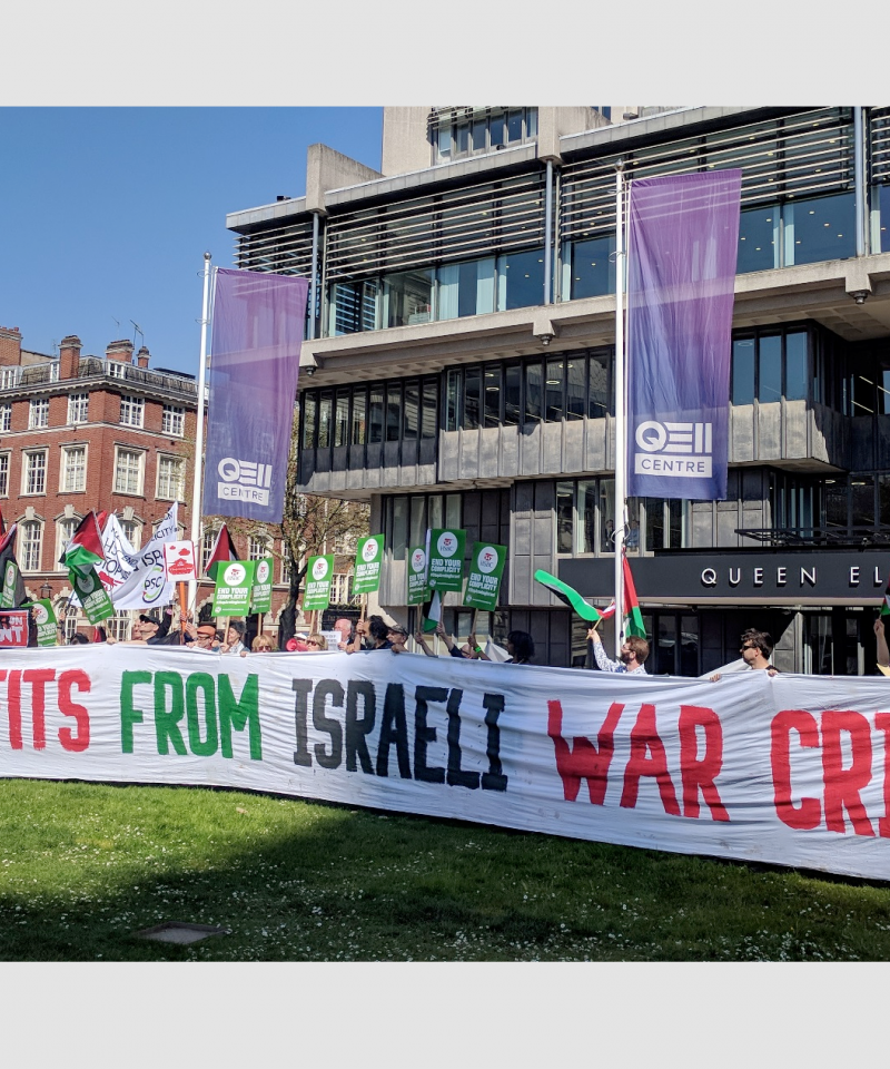 "A large group of people stand behind a banner reading ""HSBC profits from Israeli war crimes"""