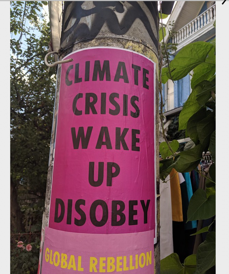 Street art from Toronto: Climate Crisis Wake Up Disobey sign