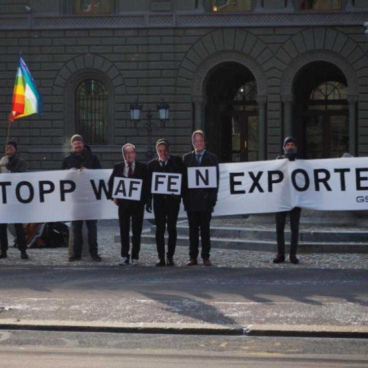 GSOA activists hold a banner against weapons exports