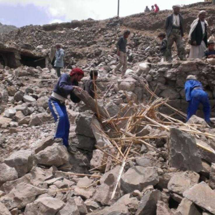 Yemeni's search rubble after a bombing