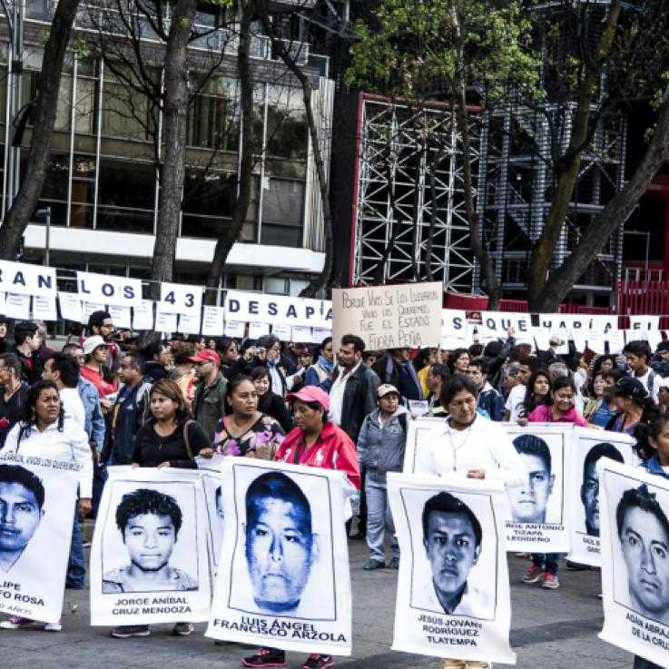 Group of people in a solidarity demostration for the 43 disappeared Ayotzinapa studens